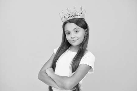 Young perfectionist. proud of her reward. luxury and success. selfish little girl wear golden crown. small princess kid. feel like champion. happy childhood. good motivation concept. she is big boss