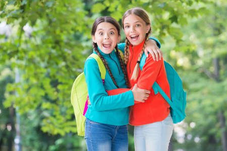 Happy friends embrace summer outdoors.