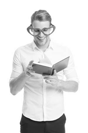 Reading is fun. Happy man read book isolated on white. Funny guy enjoy reading in fancy glasses. Bibliophile. Reading story. Using imagination. School and education. Reading makes you more creative