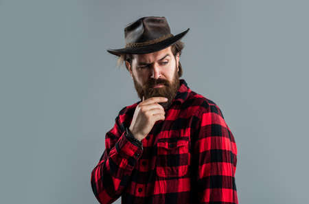 Male beauty standards. Confident and handsome brutal man. Facial care. hipster with beard. brutal caucasian hipster with moustache. Male barber care. Bearded man in cowboy hat. Hair and beard care