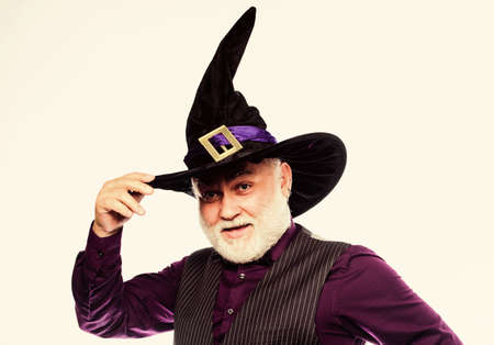 mature man magician in witch hat. bearded man ready for halloween party. evil wizard. Stargazer or astrologer. halloween holiday costume. happy halloween. Scare You Silly