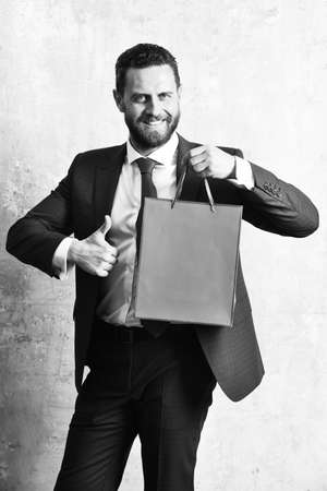 man or happy businessman with shopping bag or present pack