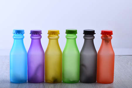 Set of bottles in different color. Row of colorful drinks