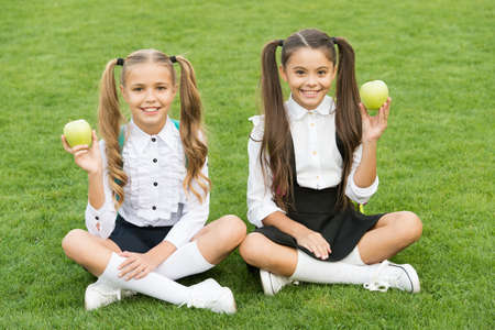 Girls classmates eat healthy school lunch, happy childhood concept