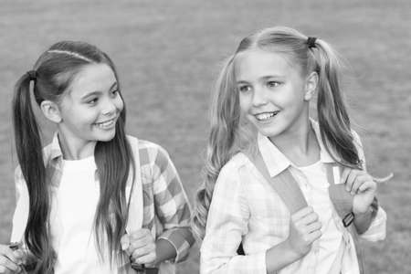 As individual as they are. Girls in pigtails. Happy girls back to school. Beauty look of little girls. Small school girls in casual style. Fashion and style. Beautiful and lovely