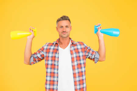 Man spraying disinfectant sanitizer around himself, cleaning day concept