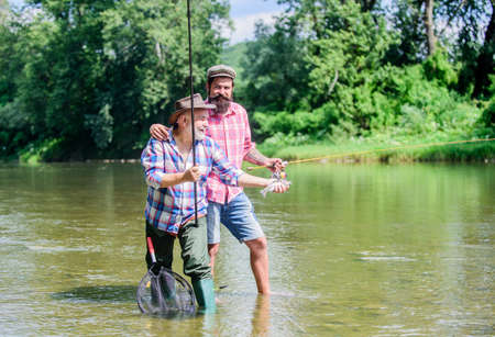 Rod tackle. Fishing equipment. Hobby sport. Fishing peaceful activity. Father and son fishing.