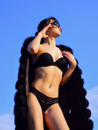 Expressing herself. Sexy woman lingerie fur coat. Richness luxury and chic concept.