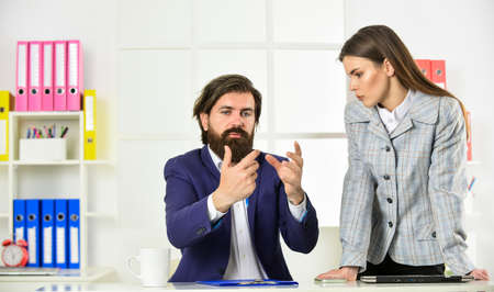 make analysis of new strategy. boss and employee work with documents. secretary hold folder. modern office life. woman and man do business. businessman consulting with colleague