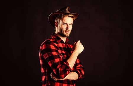 brave cowboy. Vintage style man. Wild West retro cowboy. cowboy in country side. Western. man checkered shirt on ranch. western cowboy portrait. wild west rodeo. Handsome man in hat