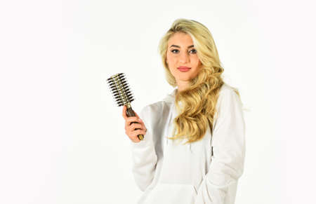 Long hair. Hair care. Hairdresser salon. Professional equipment. Easy hairdo. Beauty supplies. Avoid over drying and overheating. Hot curling brush. Pretty woman brushing hair isolated on white Standard-Bild