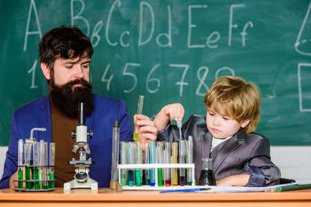 Welcome Back to School. Pupil kid in the chemistry class bearded man teacher with little boy. father and son at school. confidence & charisma. Back to school. Science chemistry concept