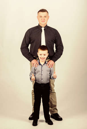 little boy with dad businessman. childhood. parenting. fathers day. happy child with father. business partner. family day. father and son in business suit. little boy love his father. cool little boy
