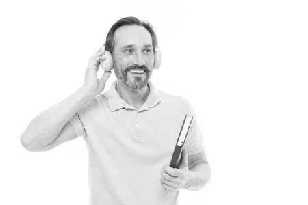 Knowledge and information. Senior business coach in headset with book. Mature student listening to ebook. Elderly businessman learning online business course. Bearded man in web school