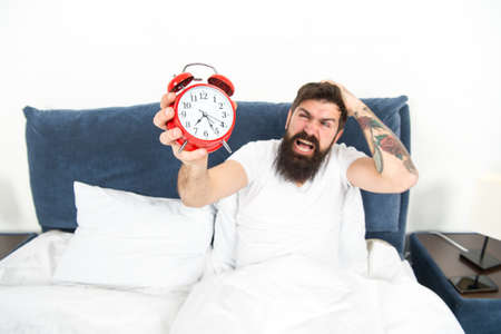 Best alarm clocks for people who hate mornings. Man bearded hipster hate wake up early. Destructive energy. Hardest moment of day. It is totally normal to hate your alarm sound. Hateful schedule 스톡 콘텐츠