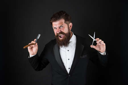 Sharp blade. Hipster handsome bearded wear tuxedo. Barber shop concept. Shaving dangerous blade. Grow mustache. Growing and maintaining moustache. Man with mustache. Beard and mustache grooming