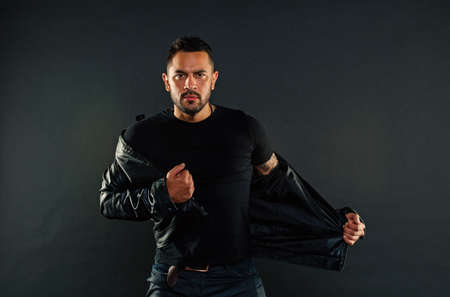 Macho undress leather jacket. Man with beard on unshaven face. Fashion model in casual style clothes. Style and trend. Mens or attraction and charisma