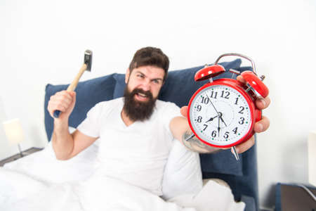 It is totally normal to hate your alarm sound. Hateful schedule. Best alarm clocks for people who hate mornings. Man angry hipster hate wake up early. Destructive energy. Hardest moment of day
