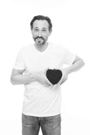 Preventing heart attack. Valentines man holding red toy heart in hands. Handsome mature man with valentines day heart. Heart problem and healthcare. Maybe this heartache will be good for him Stock Photo