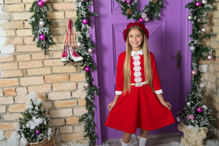 Hot dots. Fashion girl ready for Christmas celebration. Little fashionista on xmas decoration. Small girl child in Christmas dress. Fashionable little child. Small model with fashion look