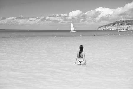Girl swimwear azure crystal ocean water rear view. Vacation luxury ocean beach resort. Swim through magical turquoise lagoon. Woman sexy body relaxing ocean beach Antigua. Enjoy paradise