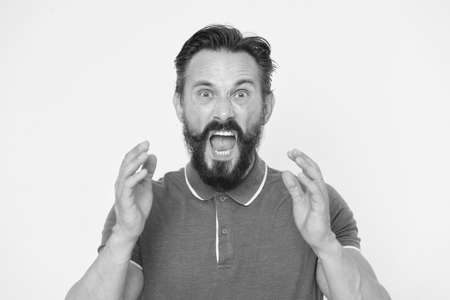 Overwhelmed with emotions. Handsome shouting mature man screaming standing against yellow background. Man bearded irritated annoyed can not keep calm anymore. Stop annoying him. Stressful adult life