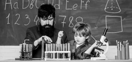 Back to school. Early development of children. Experiments in chemistry laboratory. father and son at school. teacher man with little boy. School education. science experiment in classroom activities