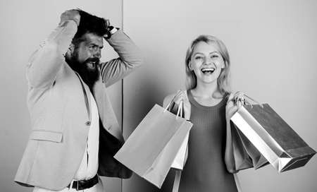 customer decision. man angry woman shopaholic. gift packages for holiday preparation. seasonal discount. black friday. shop closeout. family couple go shopping. impulse purchase. couple of shoppers