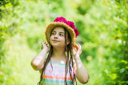 beautiful girl with flowers. little girl hold pink fresh blossoming flower bouquet of roses.