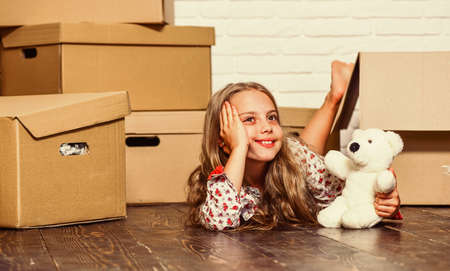 Girl small child and boxes. Move out concept. Kid moving out. Standard-Bild