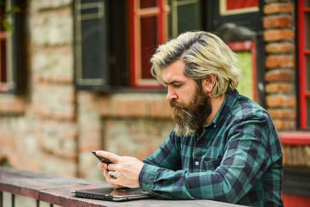 online distant education. hipster inspired to work. agile business. mature student working on computer. go shopping on cyber monday. bearded man in cafe with laptop and phone. Ready to study