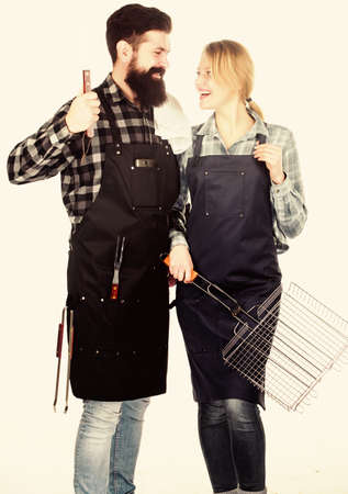 Family bbq ideas. Couple in love getting ready for barbecue. Picnic and barbecue. Summertime leisure. Man bearded hipster and girl ready for barbecue white background. Backyard barbecue party 免版税图像