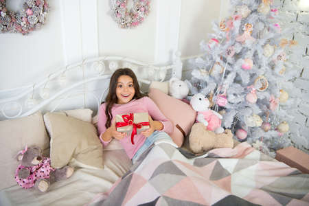 happy new year. Christmas shopping. waiting for santa. Winter. The morning before Xmas. Sleep. small girl relax at home. christmas family holiday. little child girl with xmas present