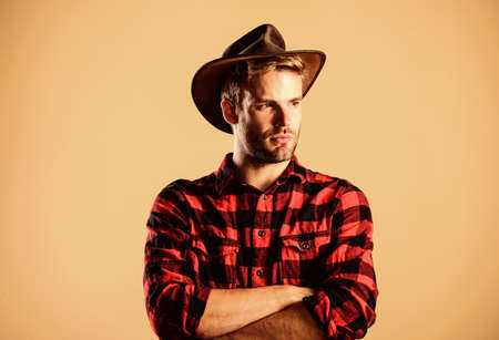 wild west rodeo. Handsome man in hat. cowboy in country side. Western. man checkered shirt on ranch. Vintage style man. Wild West retro cowboy. western cowboy portrait Stock Photo