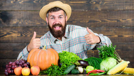 Homegrown vegetables. Buy vegetables local farm. Farm market harvest festival. Sell vegetables. Man bearded farmer with vegetables rustic style background. Locally grown crops concept. Local market Banco de Imagens