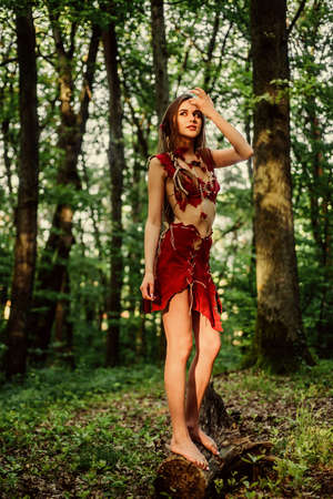 the woman went hunting. cougar female. wild woman in forest. ethnic tribal fashion. deep forest. sexy girl in leather suede clothes. amazon woman. sexy witch. Unpassable to resist Banque d'images