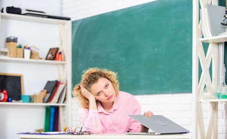 Boring homework. tired student with laptop. teacher woman. teachers day. Educational site for teachers. Online schooling concept. Girl surfing internet. Digital technologies concept. Education online