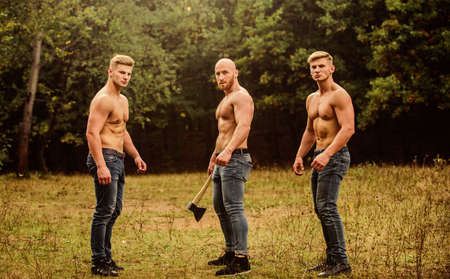 Three sexy guys. brutal guys pose with naked torso. handsome guys with sexy body. Sports and leisure. mesomorph. three muscular men with axe. athletic man use ax. bodybuilders in jeans
