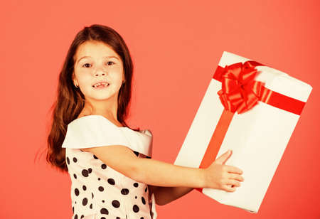 This is for you. little girl carry present. big christmas sale. kid hold gift box. boxing day concept. dreams come true. happy new year. winter holiday and xmas joy. seasonal shopping discount