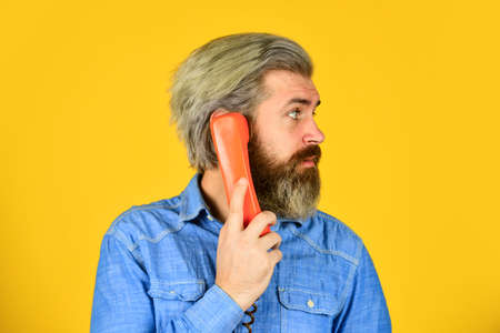 Bearded hipster man phone conversation. Successful negotiations. Retro phone. Marketing automation. Cold Calling Scripts. Outdated technology. Manager phone dialog communication. Answering machine