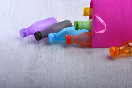 Energy drinks containers with various flavors. Shopping bag with drinks