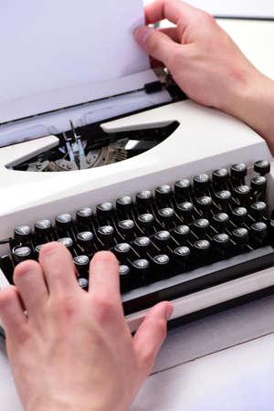 Writer typing with retro writing machine. Typography and writing