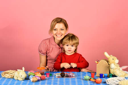 Family prepares for holiday on pink background