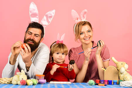 Mother, father and daughter preparing for Easter