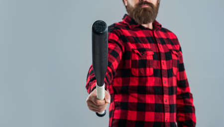 bearded male hipster ready to fight. mature man in checkered shirt. success at any cost. selective focus. man with baseball bat. i am a criminal. aggression and anger. copy space