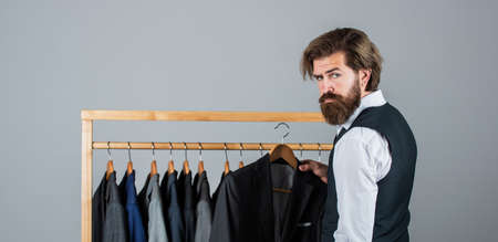 I have exactly what you are looking for. handsome sartor with tape measure. male beauty and fashion. bearded man tailoring clothes. formal and office wardrobe. tailor designing male jacket