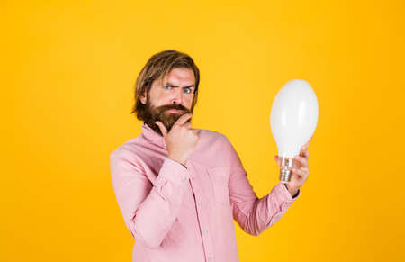 Education. hipster male holding a light bulb. electricity and people concept. Building and renovation technology. Great idea concept. idea lamp concept in hand. man with lamp illuminating his path