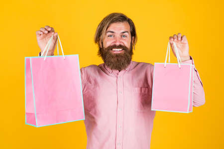 Own business. surprised man unpacking. the package delivery. human emotion and facial expression. bearded man gift holiday decoration. businessman holding gift pack. gift to colleague at work