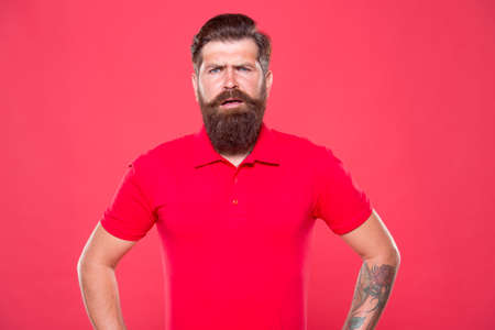 Emotional bearded hipster. Hairdresser salon. Brutality and confidence. Barbershop model. Promoting barber services. Portrait of bearded man red background. Brutal guy with mustache. Guy with beard