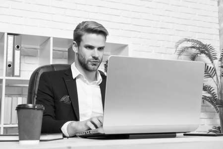 Concentrated broker. Economics recession and recovery. Financial expert man work with laptop drink coffee. Stock market concept. Financial investment Cryptocurrency. Financial director office